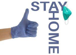 Stay Home mit Maske und Daumen nach oben