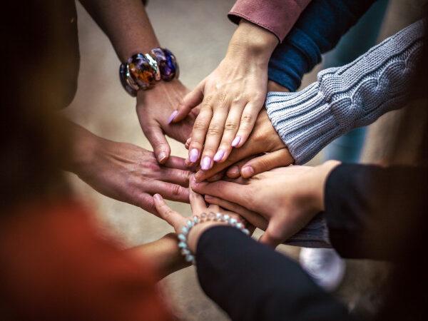 Hände zusammengelegt Teamwork Teamgeist